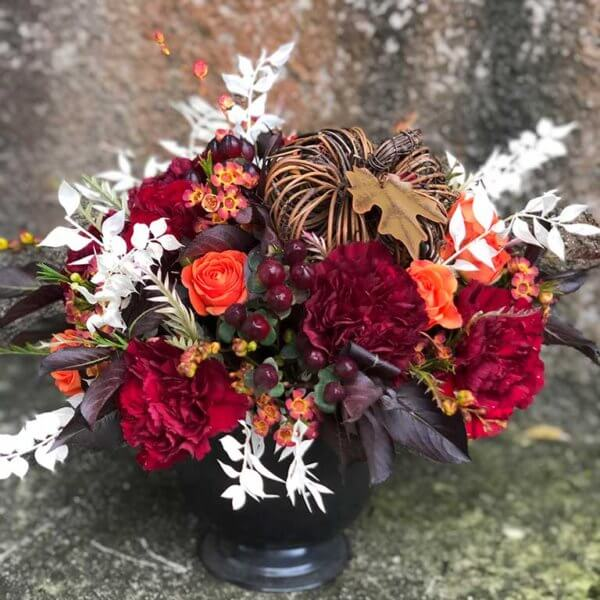 crimson and pumpkin floral arrangement