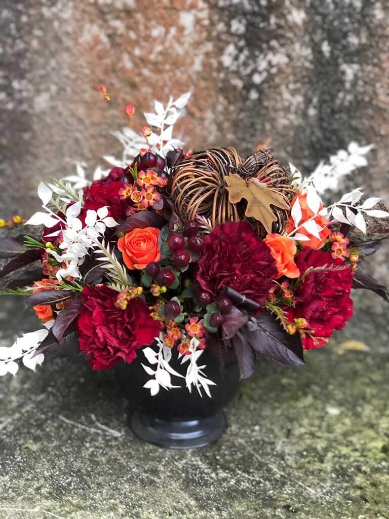crimson and pumpkin floral arrangement